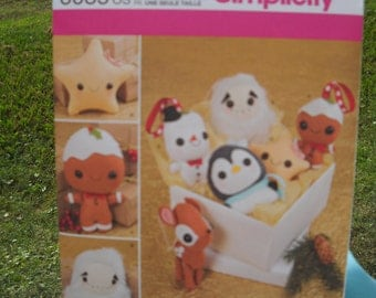 Stuffed Christmas Animals & Ornaments - Star, Snowman, Yeti, Penguin, Gingerbread Man and Deer - Simplicity Sewing Pattern 8035