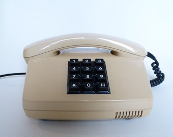 kabel phone in beige , telephone, vintage phone from the 80s, push button phone