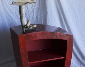 Small red wooden cabinet