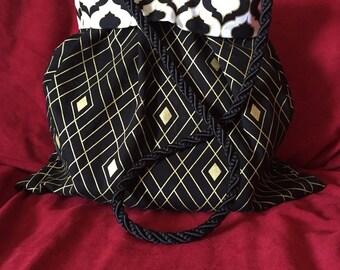 Black, white and gold handbag