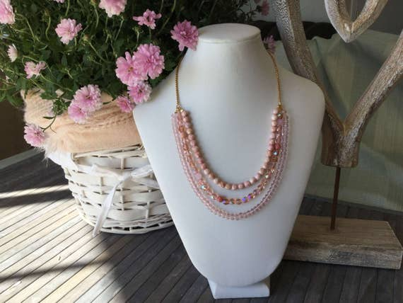 Necklace multirank of Czech glass beads to the shade of pink, chain stainless steel gold