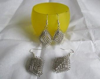 Metal mesh earrings.