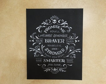 """Canvas reads:""""Promise me you'll always remember that you are braver than you believe and stronger than you seem and smarter than you think"""""""