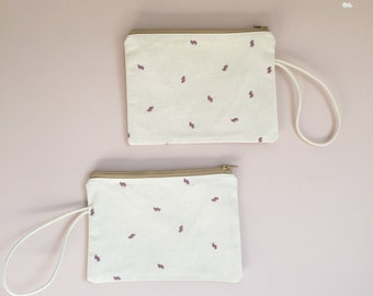 handmade embroidered purple squiggle pouch clutch with camel green zipper
