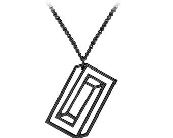 Confined silhouette optical illusion necklace pendant. Black & Silver.