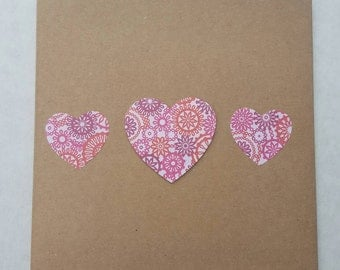Handmade greetings card with heart embellishments
