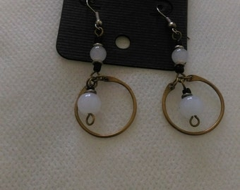 White and bronze earrings