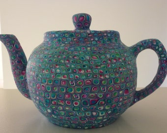 Blue mosaic, tea pot made of polymer clay on porcelain