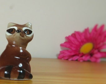 Small vintage porcelain raccoon, standing.