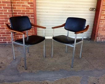 Pair of Mid Century Thonet Chairs with Black Vinyl Upholstery  and walnut Armrests.