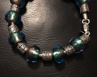 Sterling Silver Bracelet with green and blue glass beads and silver spacers.