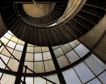 staircase of a disused power station / spiral staircase in an abandoned power plant