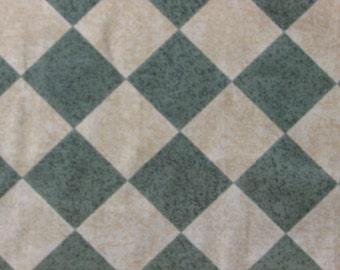 Tan and green diagonal check drapery fabric.