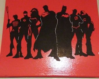 Justice league silhouette. Black and irange 12x12 canvas