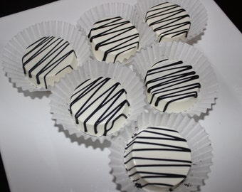 White chocolate covered Oreo's with  black swizzle