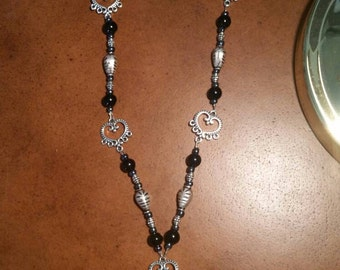 Beaded drop necklace. Silver & black