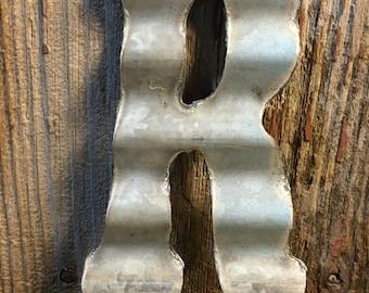 Vintage metal roofing tin letter: R
