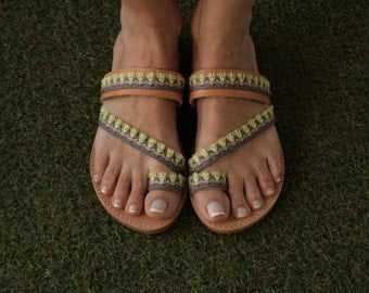 woman's sandals with ethnic trimming