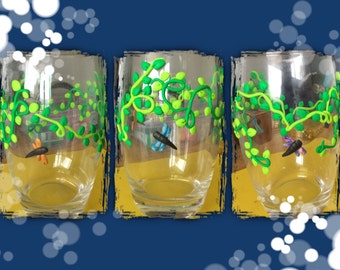 Dragonflies flying in vines glass