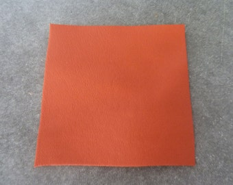 square orange leather, 6.5 cm (2.56 Inc.), fine and smooth leather