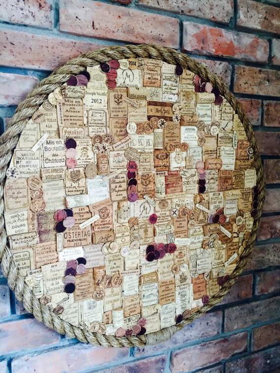 Wall decor over fireplace wine cork art wine corks collage for Decorating with wine corks