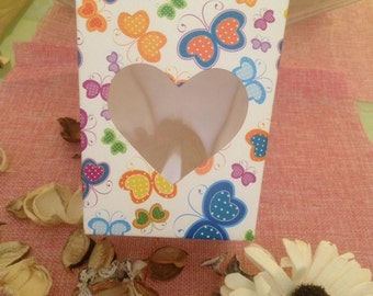 white box with colorful butterflies and with transparent heart