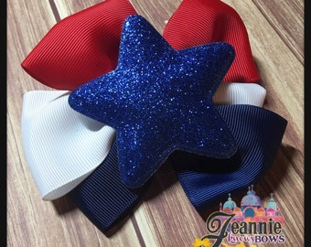Girls hair bow Red white and blue USA bow with a glitter blue star center