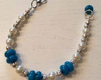 Pearl bracelet and blue stones