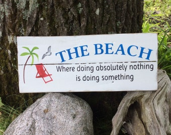 Rustic sign 'The Beach where doing absolutely nothing is doing something '