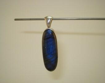 46.15 ct., Natural Blue Flash Labradorite Pendant, Oval Shape, 45 x 15 x 7 mm, .925 Sterling Silver