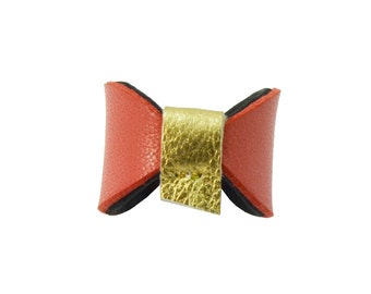 "Ring ""bow tie Mauricette"" flamingo leather and gold"