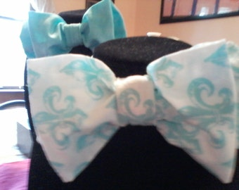 Set of two Aqua interchangeable bow ties, one aqua and white print the other is solid aqua.
