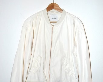 Offwhite bomber with copper coloured zipper