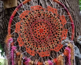 Boho, Hippie style beaded dream catcher with orange crocheted dolly