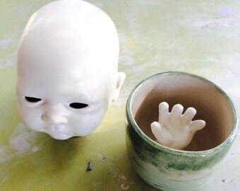 Hand reaching out mug