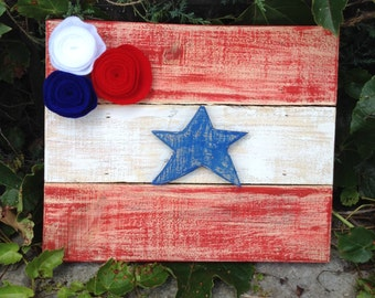 Rustic Americana flag made from reclaimed wood with red, white & blue felt flowers