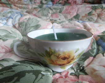 Green candle in Cup floral