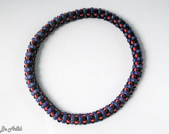 Trismic bracelet in cobalt blue, vermilion and black
