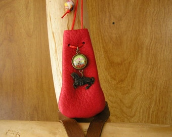 """Carousel, Red leather drawstring pouch with a glass charm, metal horse charm  3"""" x 1.5"""" adjustable 36"""" red nylon neck cord"""