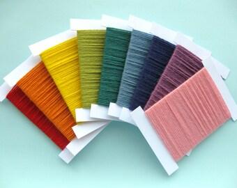 Rainbow Bobbins Garland, reels of sewing thread decoration