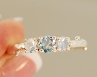 Bud Band with sky blue topaz  and Moonstones