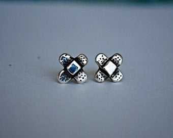 Deluxe Silver Band Aid Studs Classic X