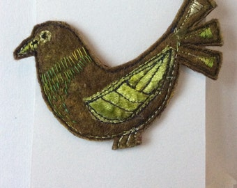 Embroidered bird brooch