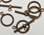 Brass toggle clasp twist design- 4 sets- bar and circle clasp in dark brass 12mm hoop and 28 mm bar easy to use toggle clasp medium toggle