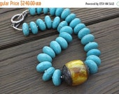 Statement Turquoise necklace with Huge Antique Tibetan Capped  Amber bead One of the Kind