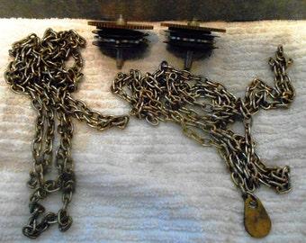 Two (2) chain pull clock mainspring assemblies