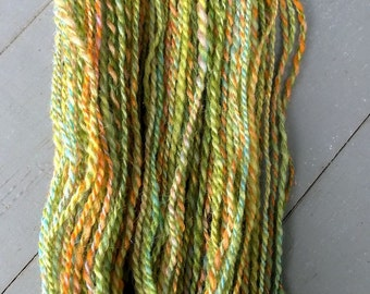 Pistachio, handspun wool, silk, mohair, and glitter yarn, 70 g/212 yds. DK yarn, sport yarn