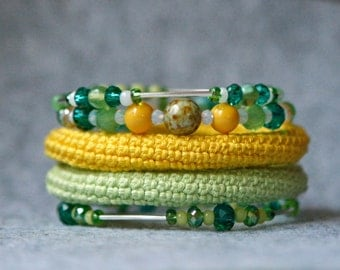 wrap bracelet with crochet cotton tube and glass beads, coiled cuff, green and yellow bangles, textile jewelry