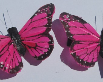 medium size pink Monarch feather butterfly hand made hair clips by Ziporgiabella
