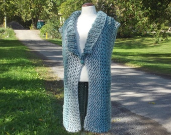Long chunky vest hand knit with collar for medium large women in ombre aqua tweed mix stripes with front button accent and slit lower sides.